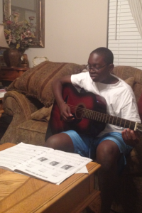 My son, practicing his guitar