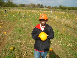 My son at the pumpkin patch sporting his Auburn cap.